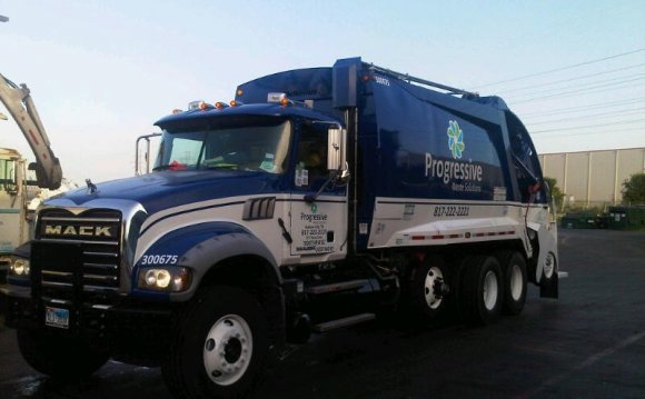 A blue, MACK dump truck with