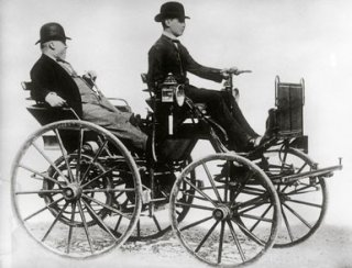 Gottlieb Daimler sitting in a motor vehicle - LOC