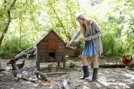 Woman feeding chickens. - Dougal Waters/Digital Vision/Getty Images